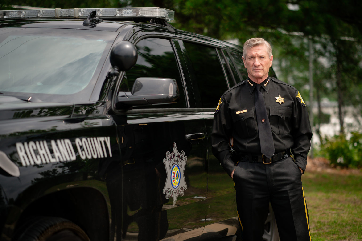 Sheriff Lott Beside A Vehicle